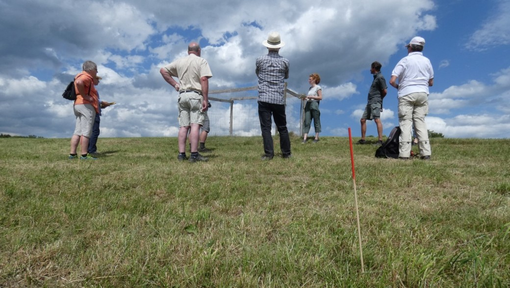 Photo shows people on a field trip by a local management team in the open countryside
